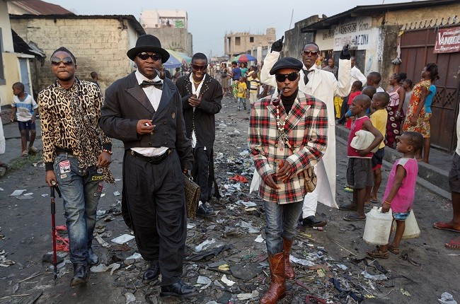 Kinshasa's young fashionistas parade the Matonge neighborhood wearing haute couture.